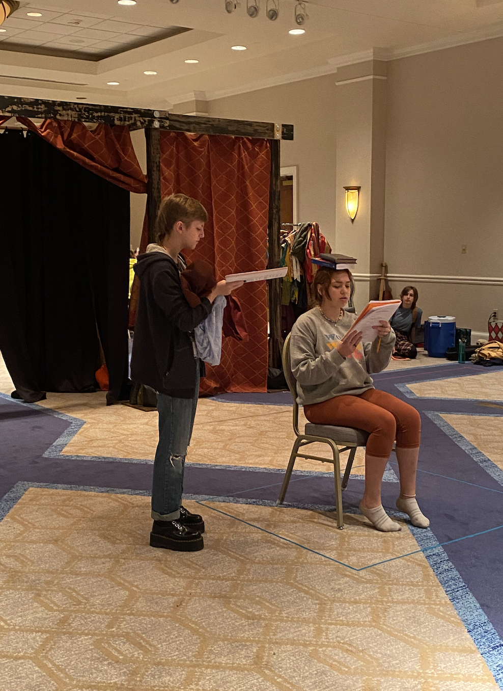 Lee (Alice) and Maddie (Katherine) rehearsing the English lesson scene (while Maddie practices her other talent of balancing books on her head)